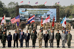 The delegation of military and political leaders representing the seven partner nations participating in Cobra Gold stands with a formation of service members during the exercise's opening ceremony. (U.S. Army/Staff Sgt. Osburn Christopher)