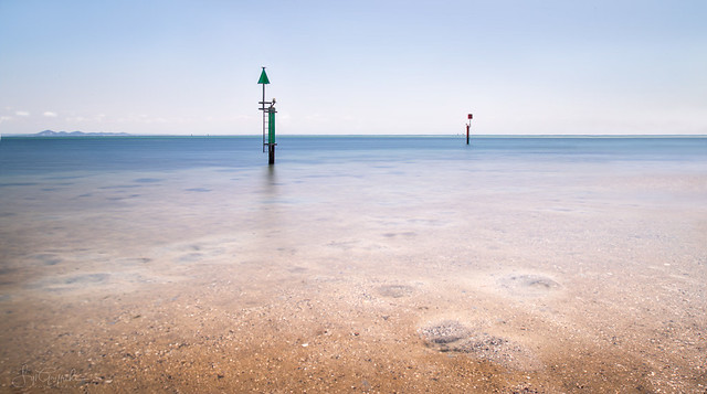 Channel Markers at Low Tide