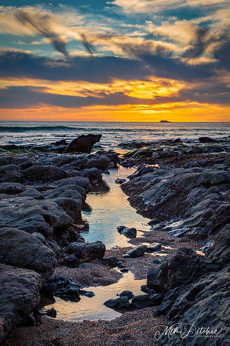 california pismobeach clouds ocean rocks seascape sun sunset vertical lowtide reflections getty gettyimages mimiditchie mimiditchiephotography