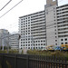 JR Nanbu Line E233 Series Train beside Trucks on Railroad at the South of Kawasaki Station Platform Widening Work Site
