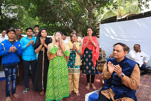 Devotee seeking blessing through song