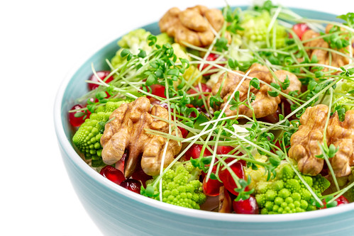 Fresh salad with walnuts, pomegranate and watercress, close-up | by wuestenigel