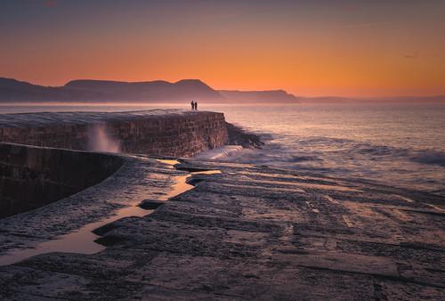 lymeregis cobb dorset unitedkingdom sunrise orangesunrise misty morning early winter 2020 reflection waves litcobb anthonywhitesphotography