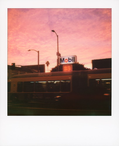 polaroid originals color 600 instant film slr680 mobil sunset western avenue koreatown ktown los angeles la california ca clouds cloudporn sundown sky gas gasoline petrol station metro bendy bus 207 motion blur palm tree silhouette toby hancock photography
