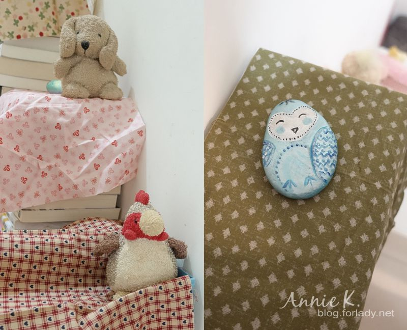 利用玩偶與石頭來固定布料