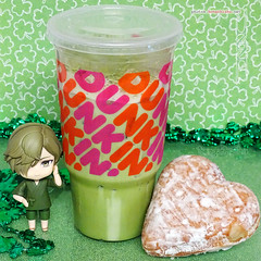 💚 Dunkin' Donuts® Iced Matcha Latte and a heart-shaped, cream filled powdered donut. 💚