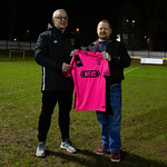 Coach Iain Ralston (left) receives the new away shirt from Neil Irvine