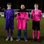 Sandy Watt (left) & Harvey Taylor receive the new away shirt from Neil Irvine