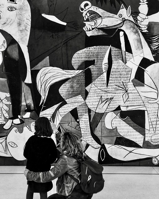 MOTHER AND CHILD LOOKING AT GUERNICA