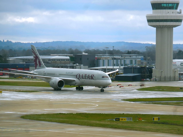 Qatar Boeing 787 A7-BCD seen taxiing into terminal at Gatwick Airport