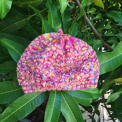 Sandi knit this sweet Lace Baby Beanie by Lora Jenkins with a skein of yarn she brought on vacation with her but didn't have a project in mind for...Perfect for this gift!