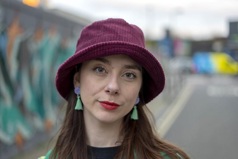 Green tassel earrings and a bucket hat