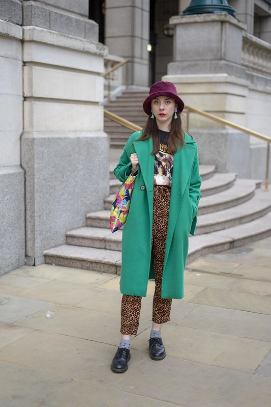 Green coat, bucket hat and labyrinth tee