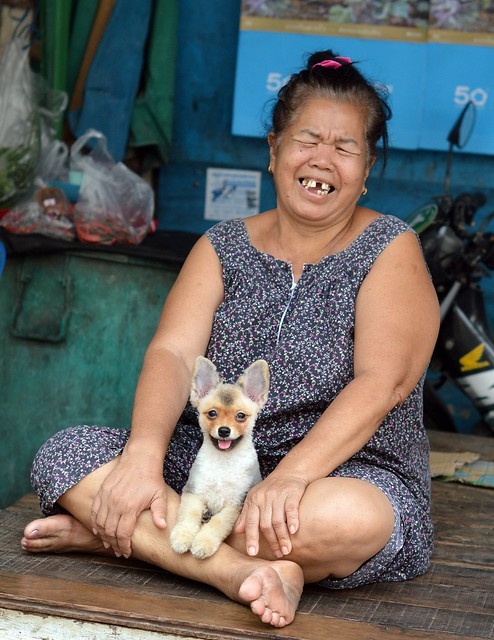 a happy lady and her fierce dog