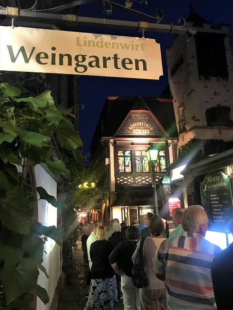 Tourists in the little famous Street DROSSELGASSE in Ruedesheim on the River Rhine in Germany - 2019