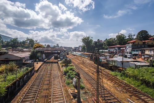 hutton station train sri lanka srilanta rail railroad track locomotive asia landscape palm clouds