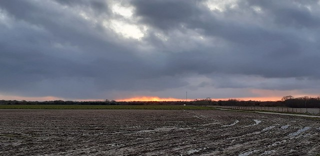 Fire in a brooding sky & waterlogged land