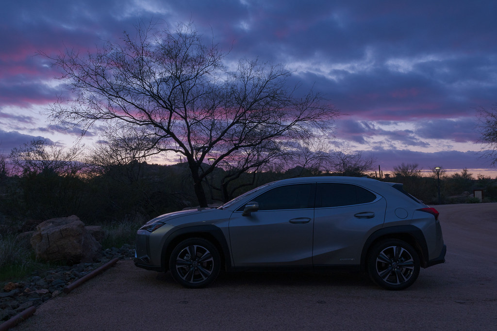 After sunset the sky is covered with pink and blue clouds as my 2020 Lexus UX 250h waits in the parking lot at George Doc Cavalliere Park in Scottsdale, Arizona in February 2020