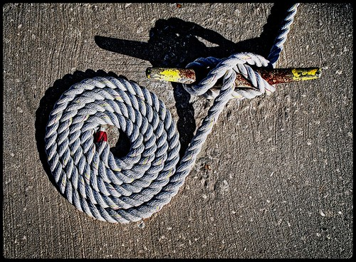 thereisaholein smileonsaturday inexplore morning lighting structure detail designelements perspective rust cleat rope marina dock wharf stilllife seeingcreatively minimalism 2020 em1mkiii hires vero flickr sunriseatthepier minimal lines pattern shadows
