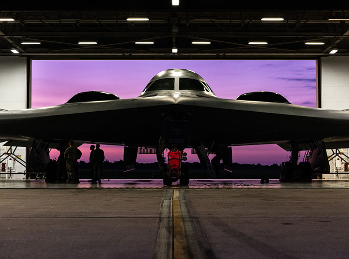 Front view of a B-2 Spirit aircraft in a hangar.