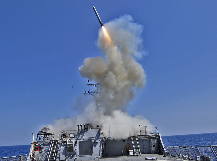 A missile is launched from a ship.