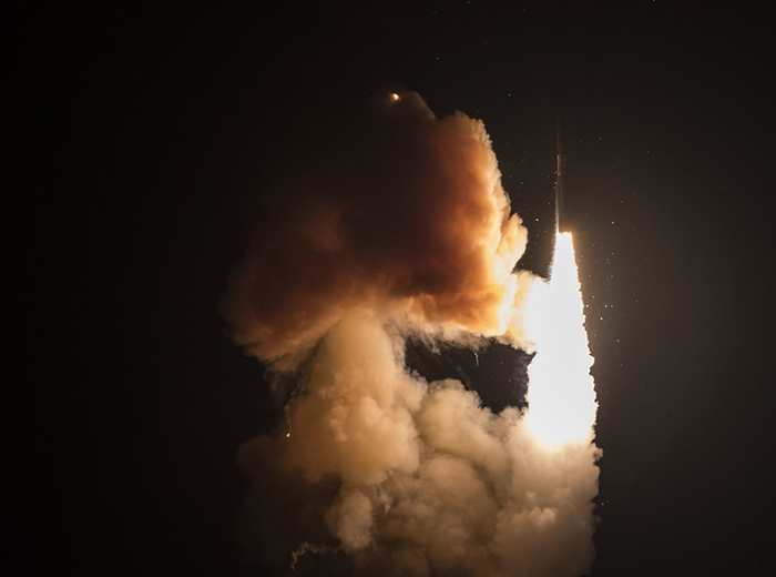 A missile launches, leaving a cloud of smoke behind.