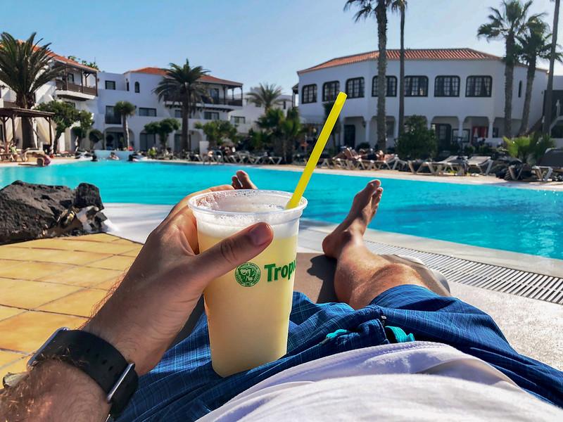 Enjoying a beer around the pool
