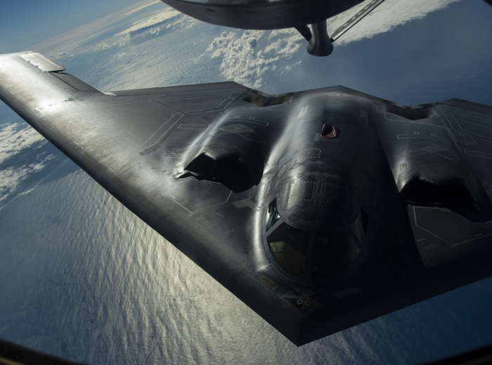 A B-2 aircraft flying over the Pacific Ocean.
