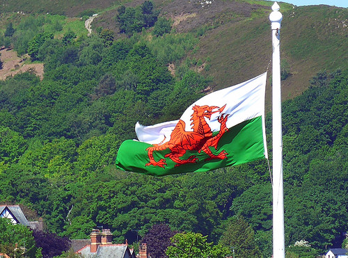 The Welsh flag flying over Conwy Castle in Wales