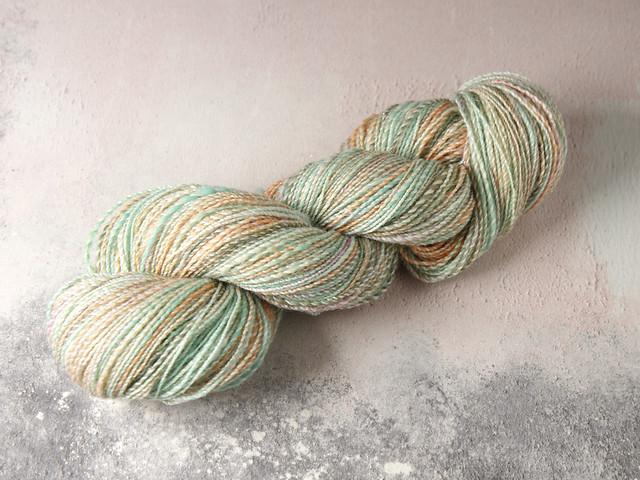 Handspun 4 ply / fingering / sock yarn in merino, silk, stellina and wool 79g – pastel turquoise and peach