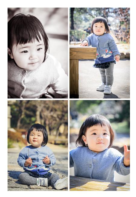 よちよち歩きの1才の女の子 公園で家族写真