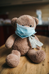 Teddy bear with a medical protective mask. Coronavirus protection.