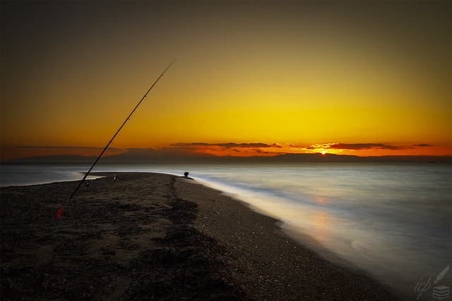 "FISHING ( ""Glow of Setting Sun"" shot )"