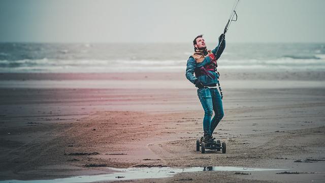 Kite surfer on land board in IJmuiden