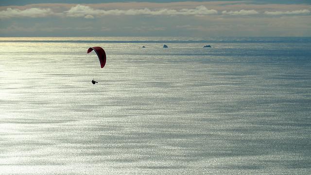 Paragliding above Stinson Beach, North Farallon Islands beyond