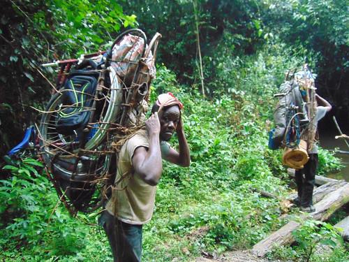 porters carry bikes, tents etc