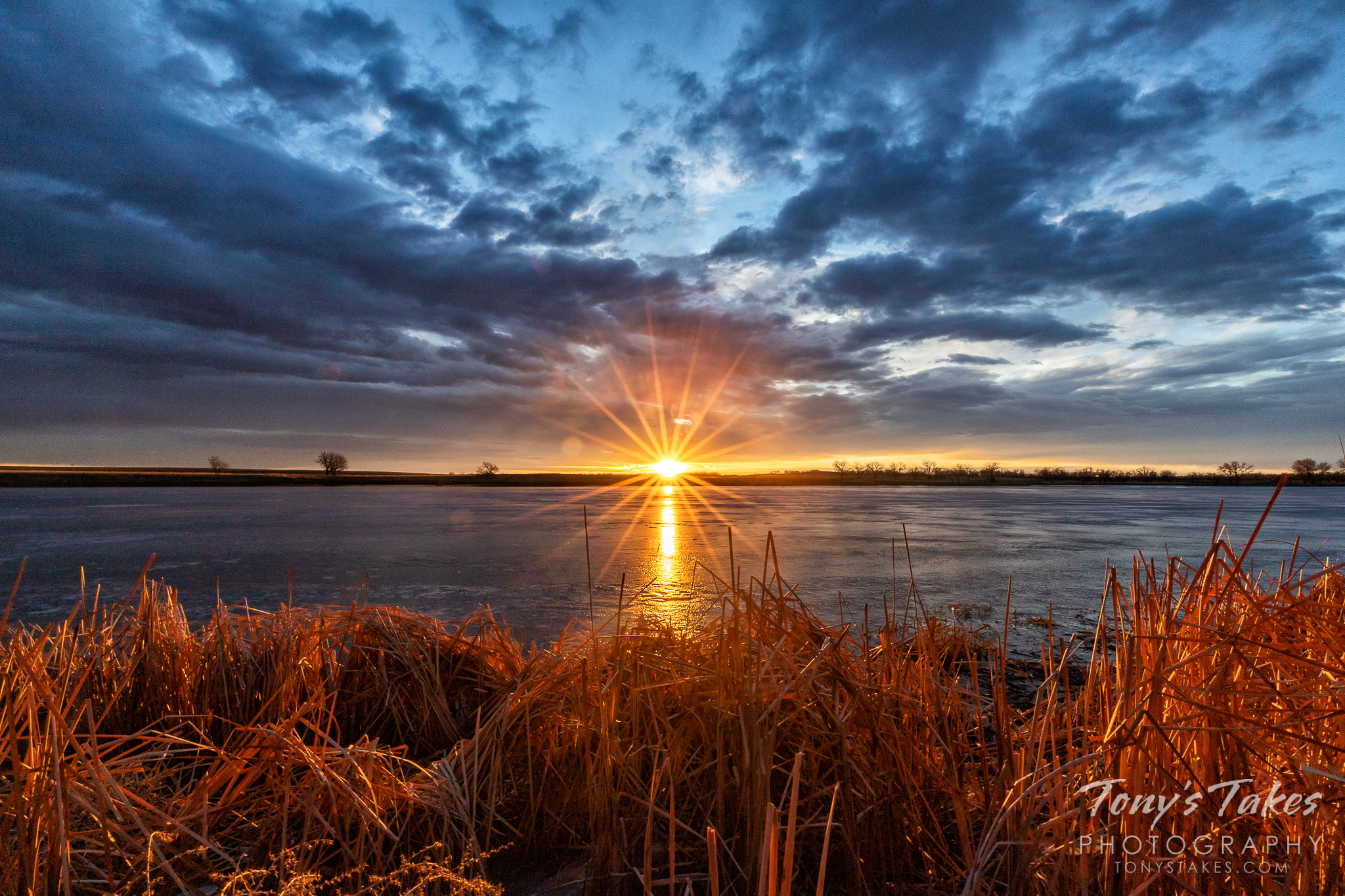 The sun bursts over the horizon on a winter's morning on the Colorado plains. (© Tony's Takes)