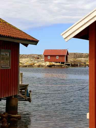 Red boathouses at Gronemad is a small town along the Bohuslän Coast of Sweden