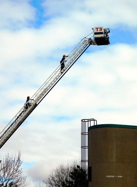 Two Firefighters Climbing Ladder on Truck 3