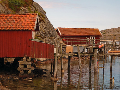 Red boathouses and docks at Gronemad is a small town along the Bohuslän Coast of Sweden