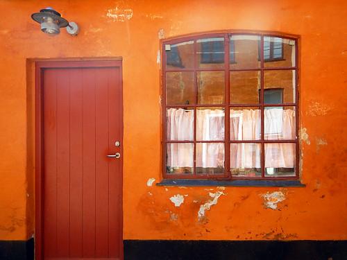 Orange wall with orange reflection in Koge, Denmark