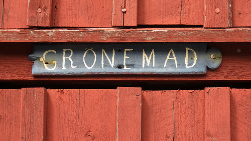 The name of the town Gronemad, posted on a typical red-painted building. Gronemad is a small town along the Bohuslän Coast of Sweden