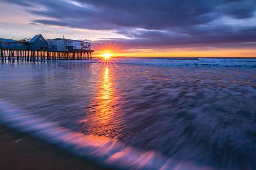 sun sunrise maine me reflections ocean atlantic sky new england beach water pier sunny winter morning canon eos pro