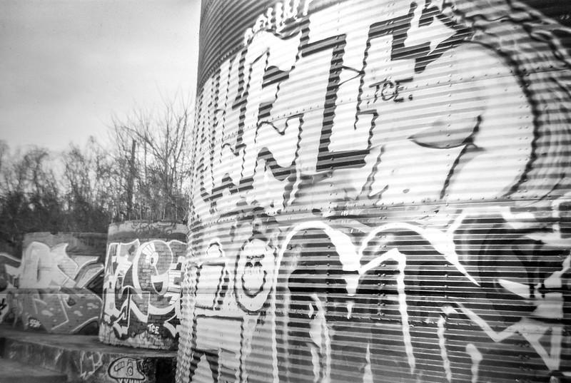 graffiti-laden facades, storage silos, one metal, two brick and mortar, railroad district, Asheville, NC, Kodak Brownie Six-20, Arista.Edu 200, Moersch Eco film developer, early March 2020