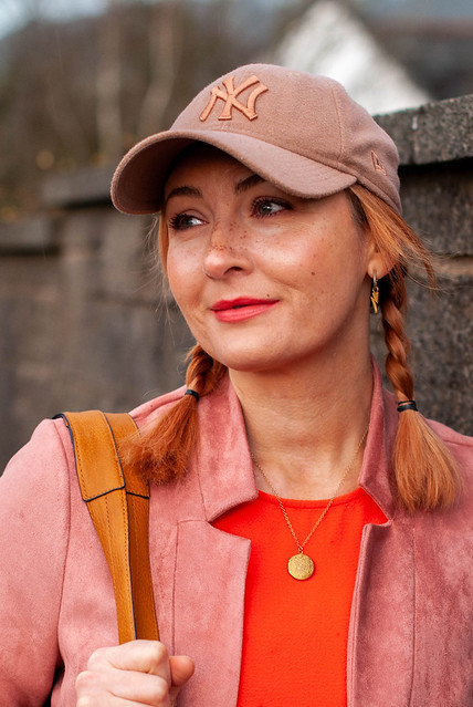 A Comfy, Casual Outfit Without Jeans (But With Trainers) - orange jumpsuit, pink longline blazer, rose gold trainers, taupe baseball cap | Not Dressed As Lamb, Style Over 40