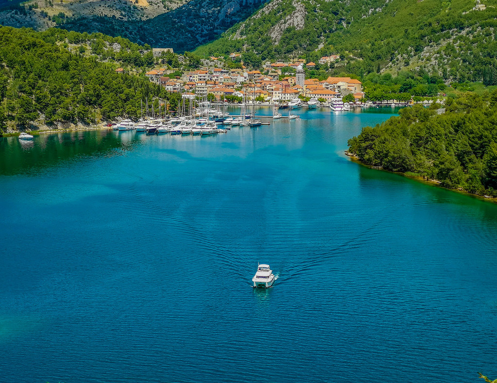 A boat leaving the majestic wharf in Skradin, Croatia.
