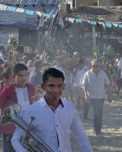The procession carrying the Virgen de la Soledad down to the boats for her annual cruise through the waters of Puerto Escondido to bless the fishing fleet