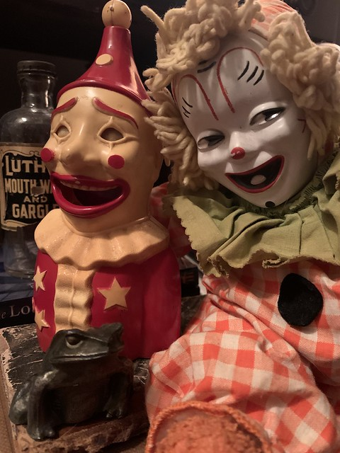 Two Creepy Clowns, a Crane & Breed Casket Co. Metal Frog, and an Antique Mouthwash Bottle