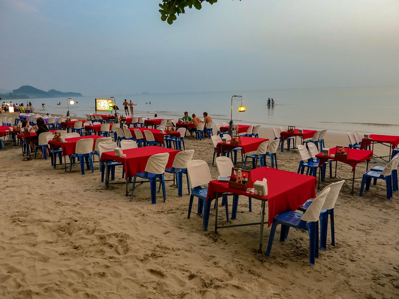 Restaurants setting up the tables on the beach for the evening