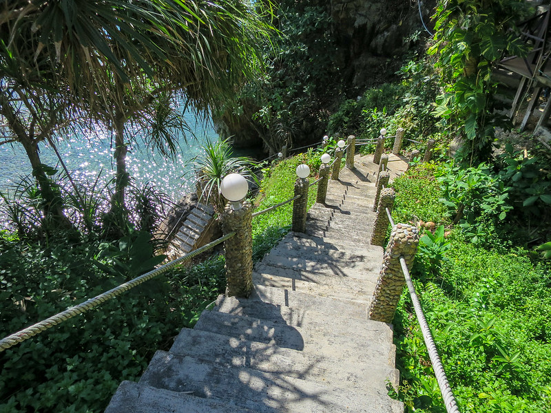 Stairs down leading down to a small private cove at Top Resort